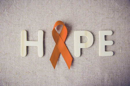 Orange Ribbons and HOPE letter on toning background, Leukemia awareness, Self Injury Awareness Day,Multiple sclerosis awareness