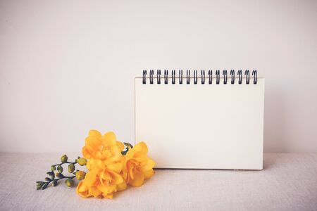 mock up: Notepad with yellow flowers mock up,  toning