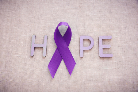 crohn's disease: Purple ribbons with HOPE word, Alzheimers disease, Pancreatic cancer, Epilepsy awareness, Hodgkins Lymphoma awareness Stock Photo