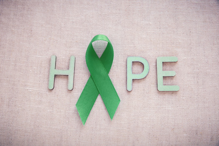 gastroparesis: Green Ribbon with HOPE word, cancer awareness, Liver, kidney cancer awareness Stock Photo