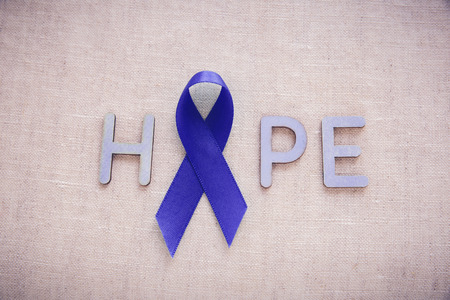 colorectal cancer: Blue ribbon with HOPE word,  Child Abuse, Colon Cancer and Colorectal Cancer Awareness Stock Photo