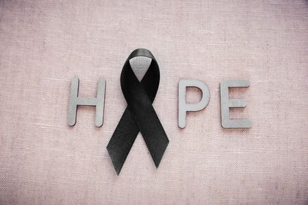 biliary: HOPE word with black ribbon, for Skin cancer awareness, Melanoma Awareness,Narcolepsy Awareness and Mourning Stock Photo