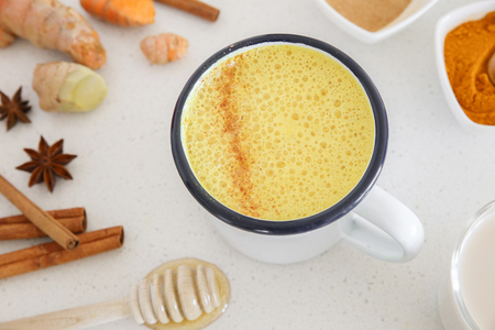 Turmeric latte, Golden milk, Turmeric milk made from turmeric, almond mink, cinnamon, ginger and honey, healthy hipster drink