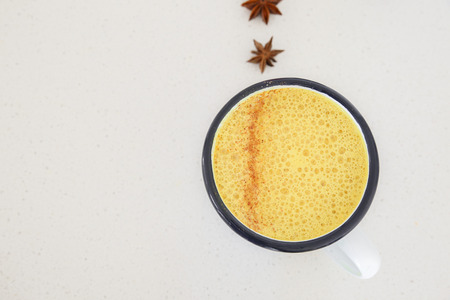 Turmeric latte, Golden milk, Turmeric milk, healthy hipster drink Stock Photo