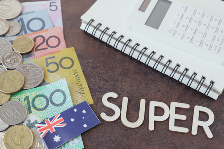Australian money, AUD with SUPER word, calculator, and notebook