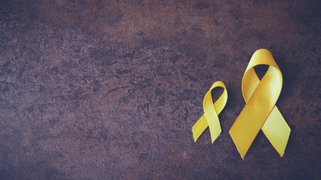 yellow gold ribbons, Sarcoma Awareness, Bone cancer, Liver cancer, Bladder Cancer, childhood cancer awareness, pamoramic banner Stock Photo