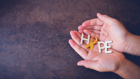 Hope with yellow gold ribbons on hands, Sarcoma Awareness, Bone cancer, Liver cancer, Bladder Cancer, childhood cancer awareness, pamoramic banner