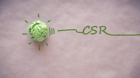 Green paper light bulb with CSR, Corporate social responsibility Stock Photo
