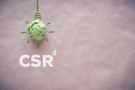 Green paper light bulb with CSR, Corporate social responsibility Banque d'images