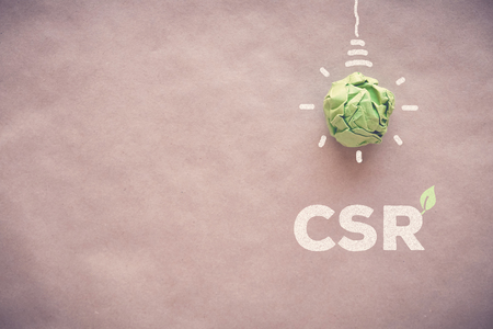 Green paper light bulb with CSR, Corporate social responsibility Stock fotó