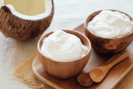 organic coconut yogurt in wooden bowl, dairy free yogurt, probiotic food