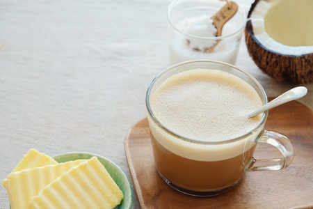 bulletproof coffee latte, blended with organic grass fed butter and MCT coconut oil, paleo, keto, ketogenic drink breakfast Archivio Fotografico