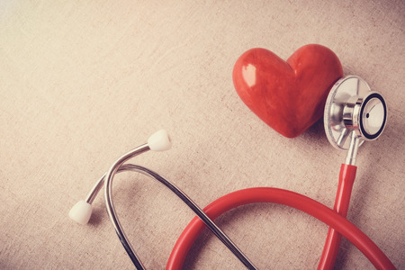red heart with stethoscope, heart health,  health insurance concept