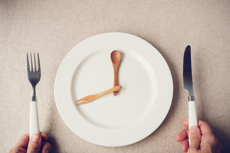 white plate with knife and fork, Intermittent fasting concept, ketogenic diet, weight loss Stock fotó