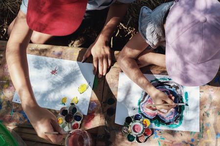 Kids painting art outdoor activity, montessori homeschooling education