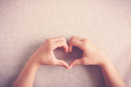 child making heart shape by hands Stock Photo