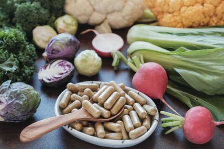 cruciferous vegetables capsules, dietary supplements for healthy Фото со стока