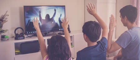 Children praying with father parent , family and kids worship online together at home, streaming church service, social distancing concept Banque d'images