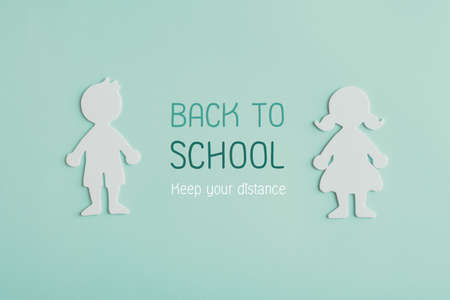 Boy and girl student paper cut with word Back to school, keep your distance, school reopening after covid-19 coronavirus is over, new normal concept