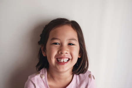 Portrait of happy Asian young little girl smiling, child oral dental care
