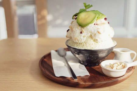 Healthy bingsu shaved ice dessert with almond and avocado topping, ketogenic low carb vegan plant-based dessert