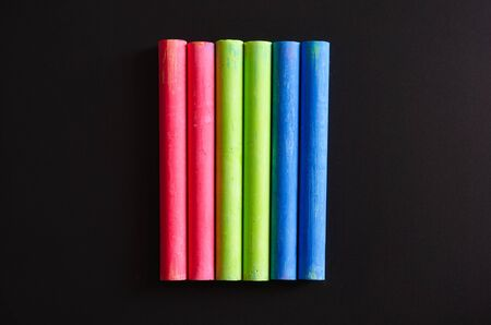 white chalks: variety of color chalk on blackboard.