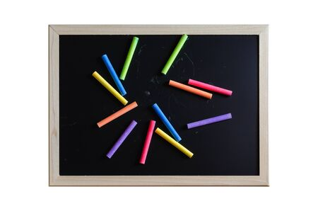 white chalks: colorful color chalk variety on blackboard. Stock Photo