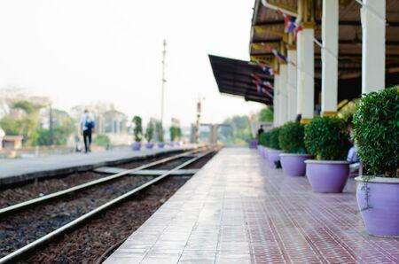 blur track railway and platform train station. Stock Photo