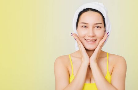 Adolescent asian woman portrait skin care beauty face and good health care with allure posing against yellow background with clipping path. woman beautyful skin and healthy care concept.