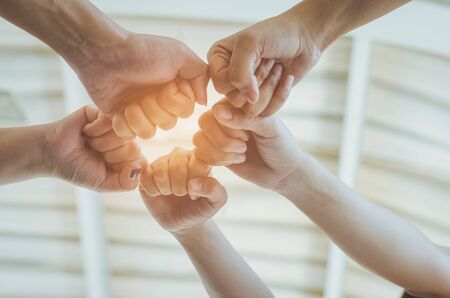 teamwork concept of diversity multiethnic people with group hands bump for relationship and together.
