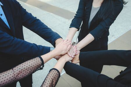 teamwork concept of diverse multiethnic business people with group hands put and stack holding with power team for relationship and success together. Collaboration, harmonious working concept.