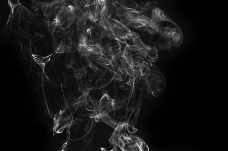 abstract fragment movement of burn white smoke on black background. Banco de Imagens
