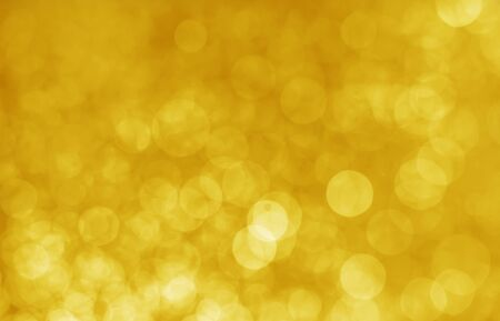 abstract yellow bokeh glitter sparkle background.