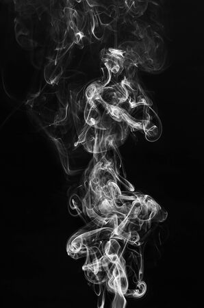 abstract beautiful fragment movement of burn white smoke on black background.