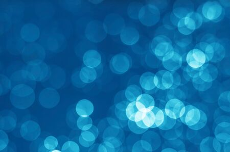abstract blue bokeh glitter sparkle background. Banco de Imagens