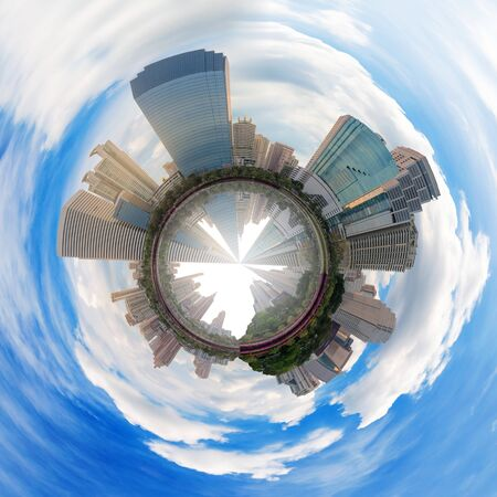 circle polar view of panorama skyscraper cityscape of high building in modern city at day view form the park with blue sky and cloud. Banco de Imagens