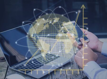 businessman using mobile phone and laptop with global network connection hologram and graph diagram business growth up on strategy future planning concept.
