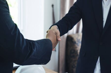 attractive business man hand shaking for complete business deal together successful. teamwork concept. partnership concept and dealership concept.