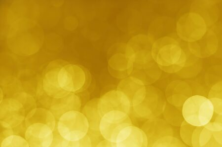 abstract yellow gold bokeh glitter sparkle background. Banco de Imagens