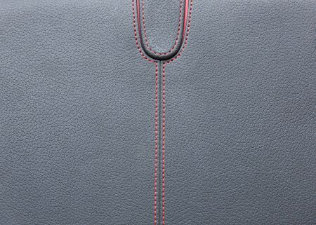 Black horizontal with red stitched leather background