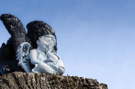 angle statue on bule sky background
