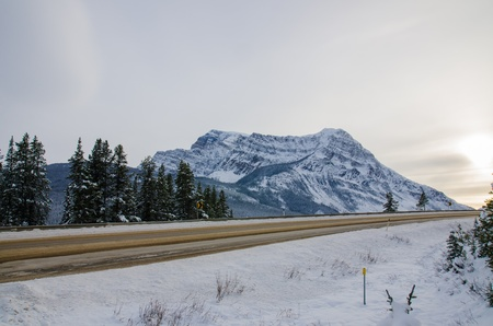 The road in the Banff national park with Rockies Mountain background Stock Photo