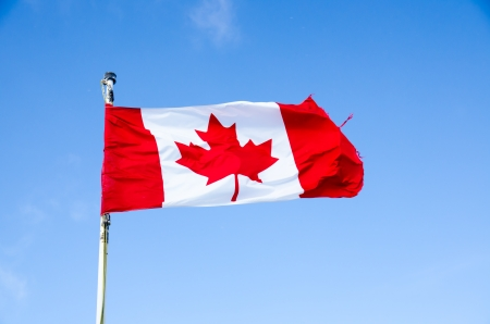 Canada flag on blue sky  background Stock Photo