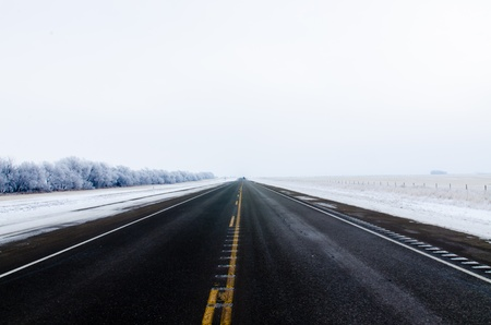 Road in winter time at Drumheller, Alberta, Canada Stock Photo