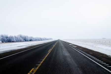 Road in winter time at Drumheller, Alberta, Canada Stock Photo - 16720733