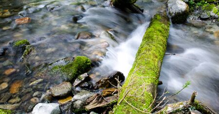 mossy: Cascade waterfall with mossy rocks