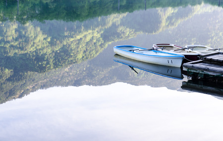 Boats with reflection background,Kamigochi, Japan