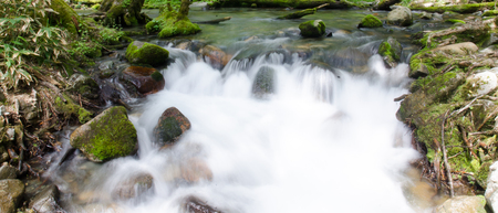 Cascade water fall with mossy rocks