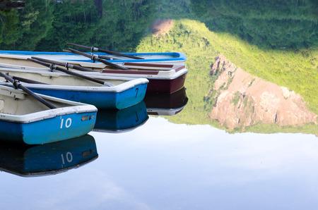 Boats with mirror effect at lake, kamigochi, Japan Stock Photo