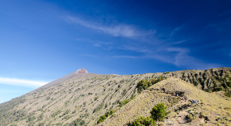Summit of rinjani with blue sky background